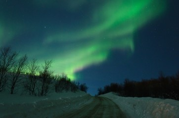 Aurora,Northern lights over the hills and road.