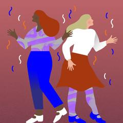 Two women dancing in confetti