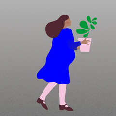 Pregnant woman carrying a potted plant