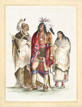 Old watercolor illustration of a North American indian family dressing traditional clothes and traditional items. By G. Catlin, Catlin's North American Indian Portfolio, Ackerman, 1845
