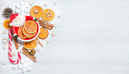 Christmas frame made from Santa Claus oranges. cinnamon, candies, various festive decor. copy space, free space for your text. close up