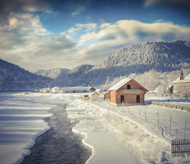 Sunny winter view in Carpathian village with no frozen river