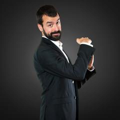 Handsome businessman making time out gesture on black background
