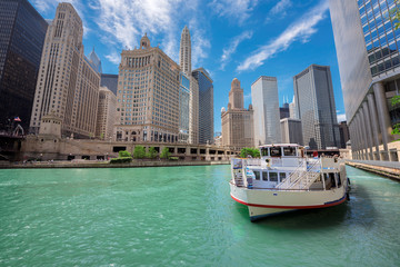 Chicago downtown and Chicago River with tourit ship during sunny day, Illinois, USA.