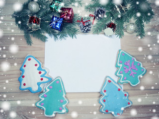 christmas cookies greeting card and decoration on wooden background