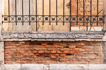 Old fence detail. Brick and stone wall.