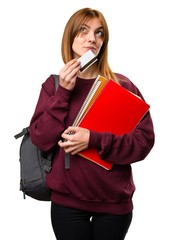 Student woman holding a credit card