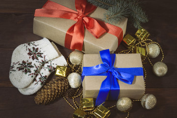 Packed gifts, fir cones, socks, decorative gift wraps and balls