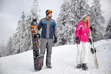skiers couple on snowy mountain