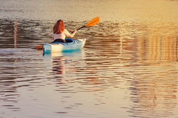 A girl in a blue kayak