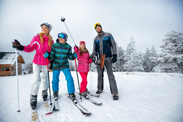 winter time and skiing - family with ski and snowboard on ski have fun