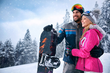 love smiling couple enjoying on winter vacation together on the mountain
