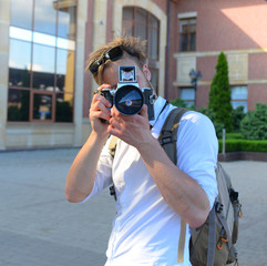 Young traveller or photographer goes sightseeing