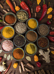 Spices, herbs on a wooden table