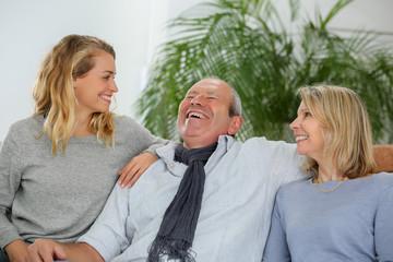family having fun on sofa