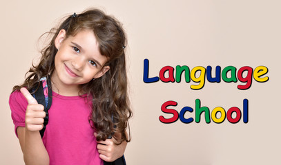 Smiling cute young girl showing thumb up with text Language School. Different color letters.
