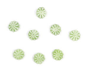Green menthol candies isolated on white background, top view