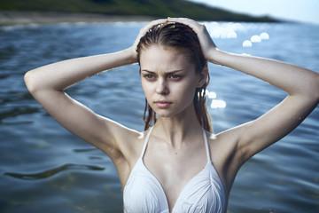 Serious woman wearing a bikini in ocean