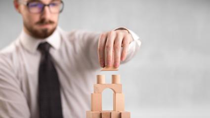 Businessman building a tower