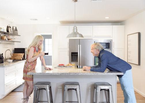 Caucasian couple talking in the kitchen