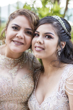 Portrait of smiling Hispanic mother and daughter
