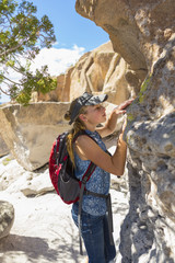 Portrait of Caucasian girl examining rock