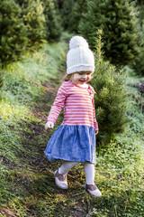 Toddler girl walking on path