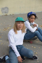 Two young women on skateboards