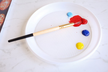 Paint brush and colorful paint
