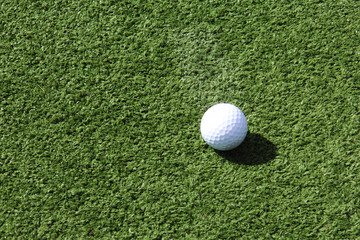 Close up of white golf ball on golf green