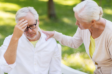 senior man suffering from headache outdoors