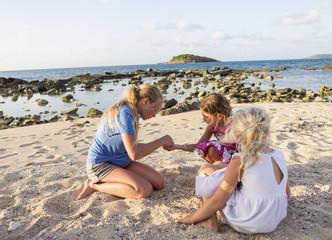 Caucasian girls playing at beach