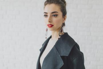 Portrait of glamorous Middle Eastern woman wearing earrings