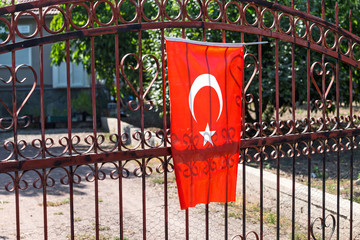 Turkish Flag on a fence of a private house