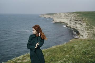 Caucasian woman standing near ocean