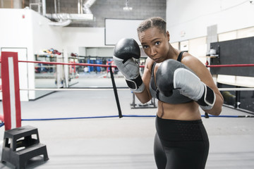 Black woman posing in boxing ring