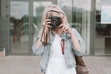 Caucasian woman photographing with camera