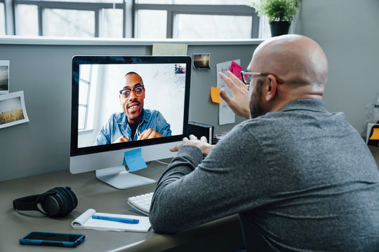 Businessmen on video conference