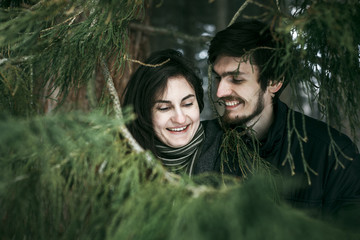 Caucasian couple smiling near tree