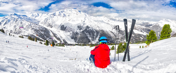 Young skier enjoying the view in Tyrolian Alps, Zillertal, Austria