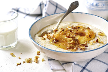 Oat porridge with caramelized pear and nuts.