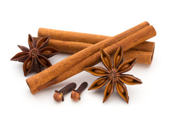 Cloves, anise and cinnamon isolated on white background.
