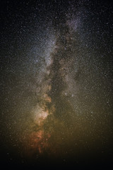 Vertical background of starry night sky with the Milky Way