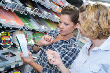 women shopping notebooks and writing paper in stationary store