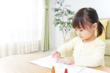 A child painting pictures