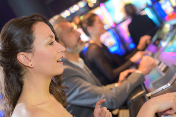 group of people playing slot and various machines