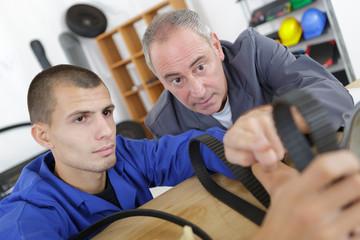 Apprentice mechanic with tutor