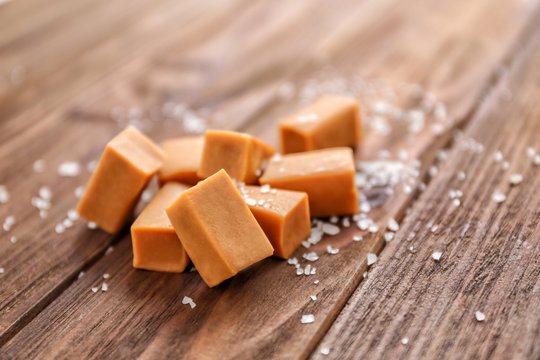 Salted caramel candies on wooden table