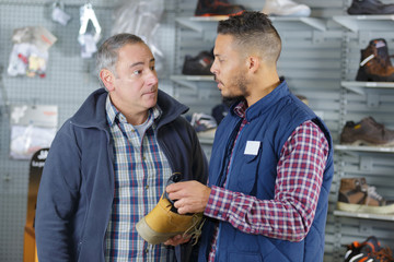 male selling working shoes to mature man