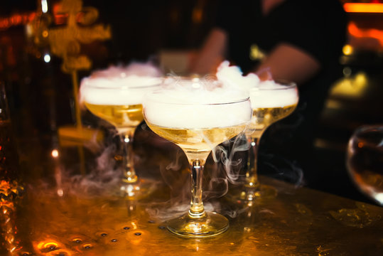 Cocktails with smoke in the nightclub